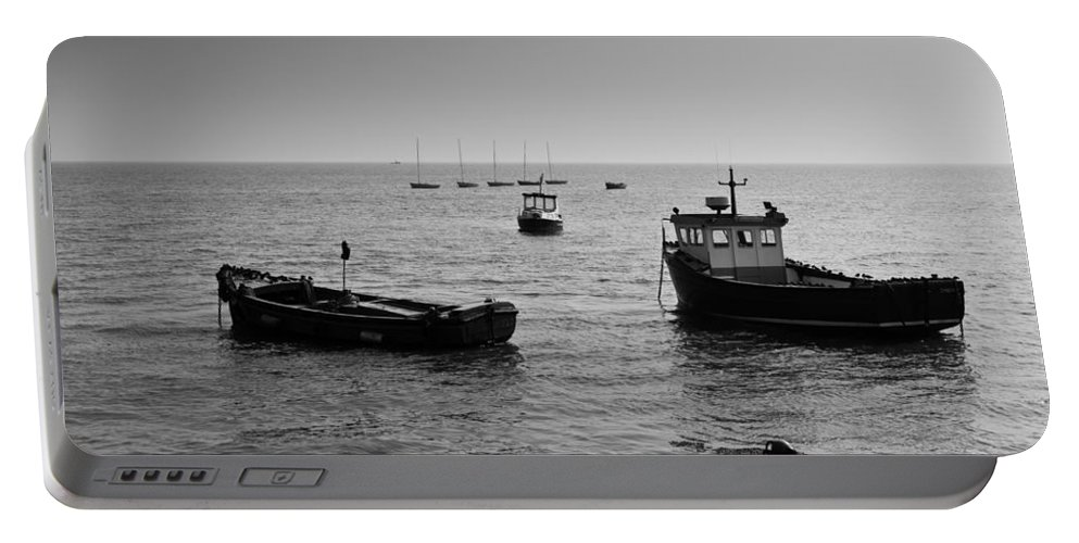 Dinghie Portable Battery Charger featuring the photograph Boats Moored Off Of Leigh Essex by David Pyatt