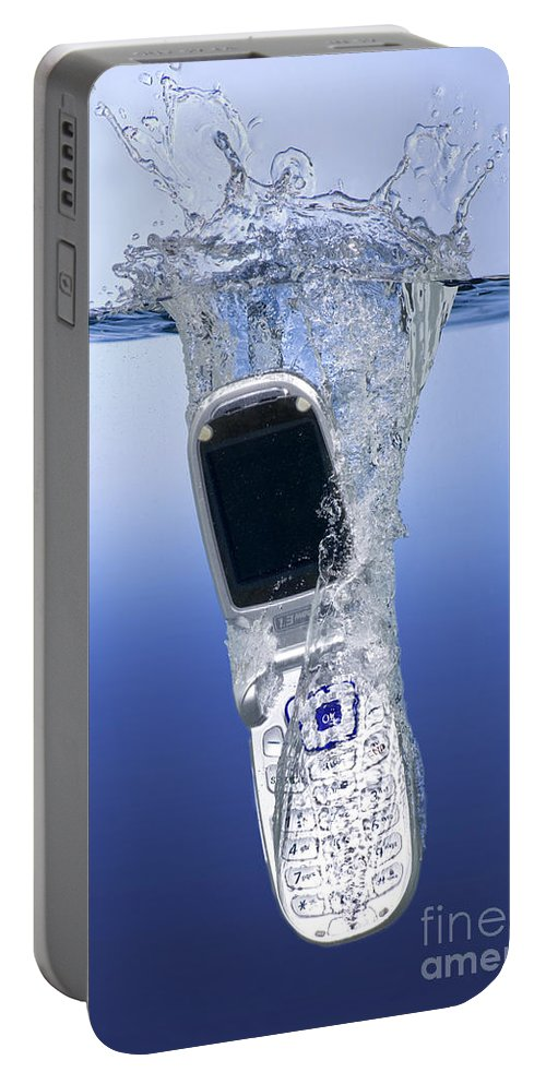 Cell Phone Portable Battery Charger featuring the photograph Cell Phone Dropped In Water by Ted Kinsman