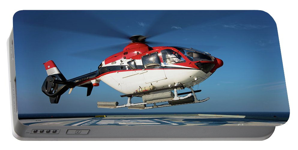 Horizontal Portable Battery Charger featuring the photograph Eurocopter Ec135 Utility Helicopter by Terry Moore