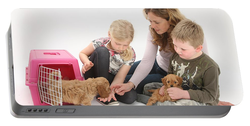 Animal Portable Battery Charger featuring the photograph Family With Cockerpoo Pups by Mark Taylor