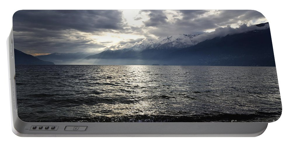 Sunlight Portable Battery Charger featuring the photograph Sunlight Over A Lake by Mats Silvan