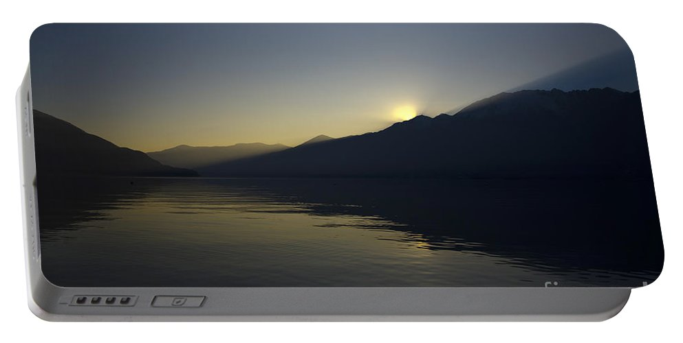 Sun Portable Battery Charger featuring the photograph Sunset Over An Alpine Lake by Mats Silvan