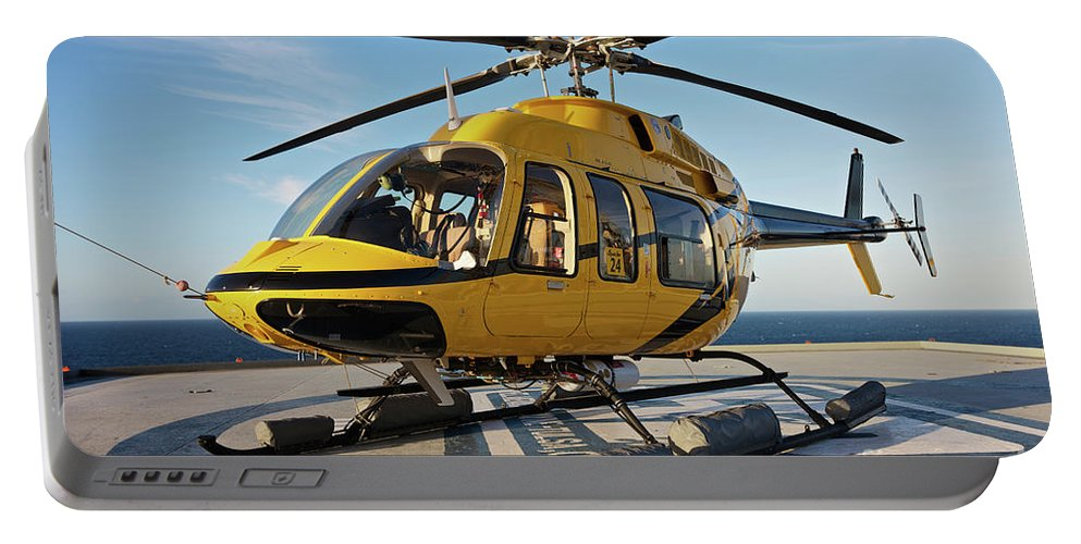 Louisiana Portable Battery Charger featuring the photograph A Bell 407 Utility Helicopter by Terry Moore