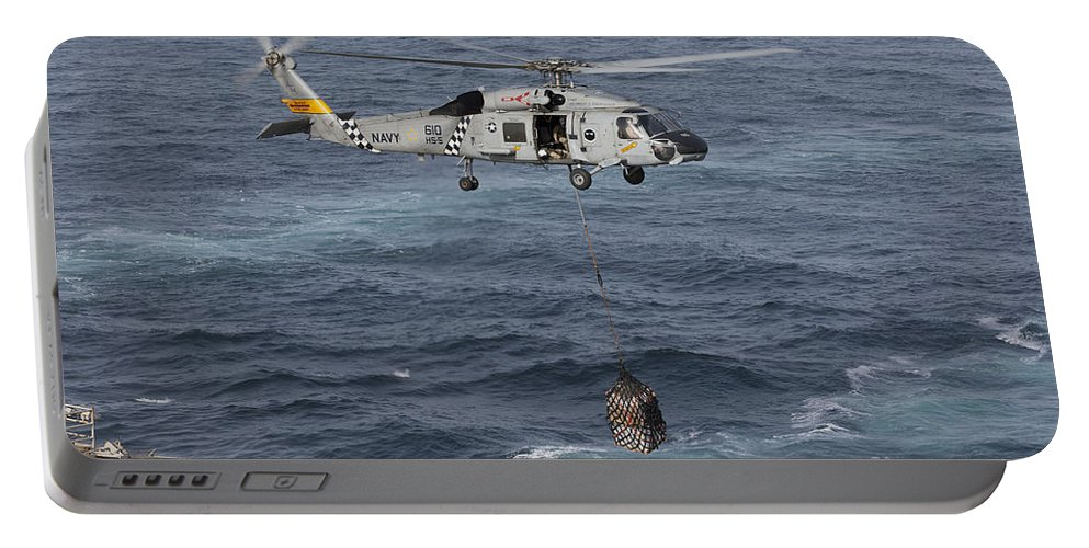 Arabian Sea Portable Battery Charger featuring the photograph A Sh-60j Seahawk Conducts A Vertical by Gert Kromhout