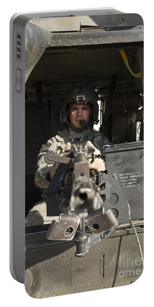 Aviation Portable Battery Charger featuring the photograph A Uh-60 Black Hawk Door Gunner Manning by Terry Moore
