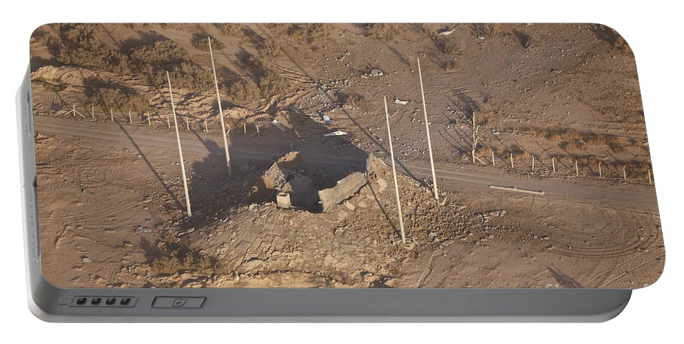 Operation Iraqi Freedom Portable Battery Charger featuring the photograph Aerial View Of A Destroyed Iraqi by Terry Moore