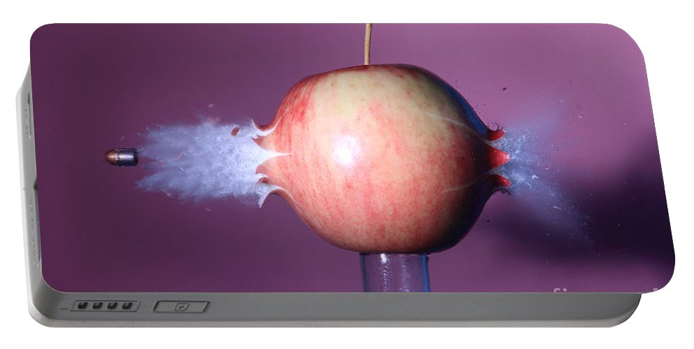 Science Portable Battery Charger featuring the photograph Bullet Hitting An Apple by Ted Kinsman