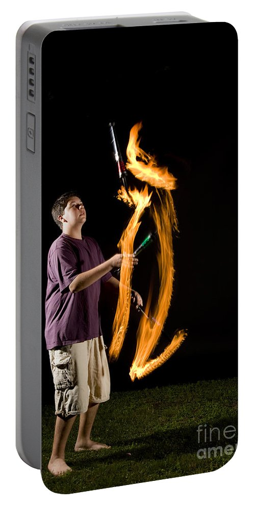 Flame Portable Battery Charger featuring the photograph Juggling Fire by Ted Kinsman