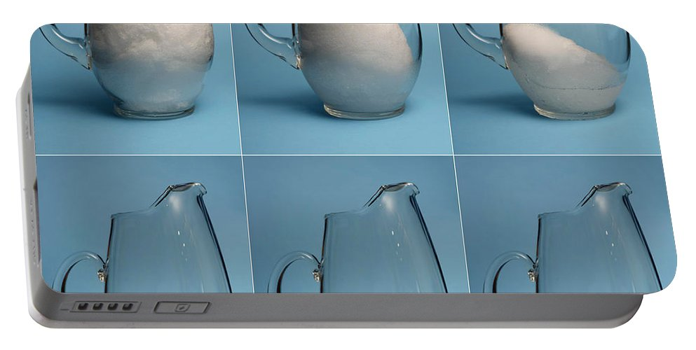 Snow Portable Battery Charger featuring the photograph Snow Melting by Ted Kinsman