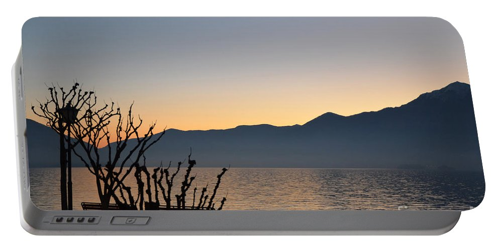 Blue Portable Battery Charger featuring the photograph Sunset Over An Alpine Lake by Mats Silvan