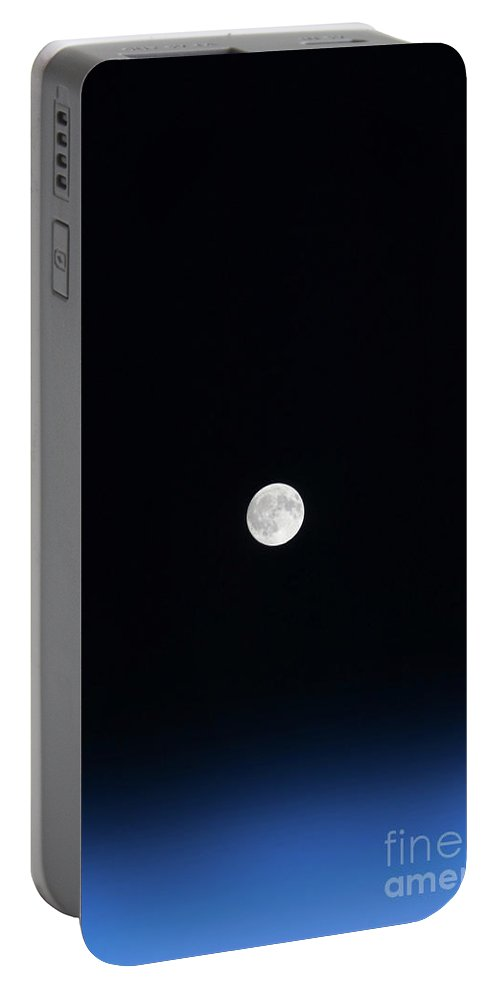 View From Space Portable Battery Charger featuring the photograph The Moon And Earths Atmosphere by Stocktrek Images
