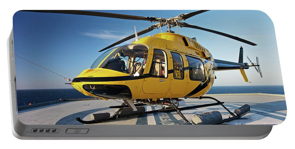 Rig Portable Battery Charger featuring the photograph A Bell 407 Utility Helicopter by Terry Moore