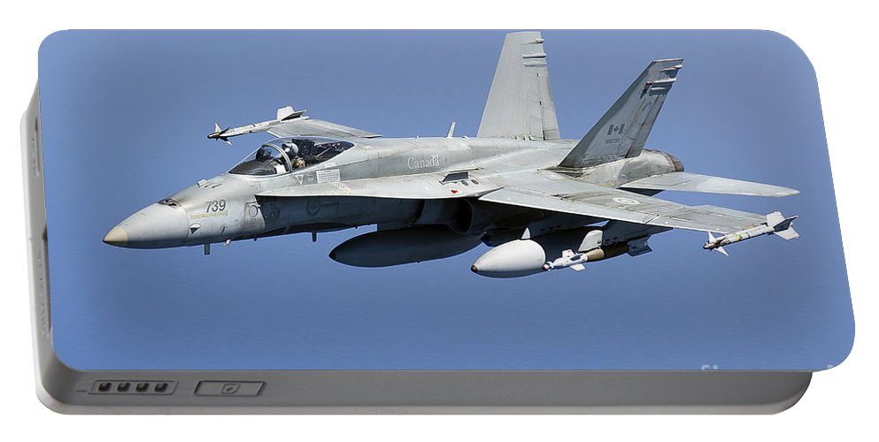 Libya Portable Battery Charger featuring the photograph A Cf-188a Hornet Of The Royal Canadian by Gert Kromhout