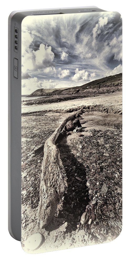 Driftwood. Manorbier Beach Portable Battery Charger featuring the photograph Driftwood by Steve Purnell