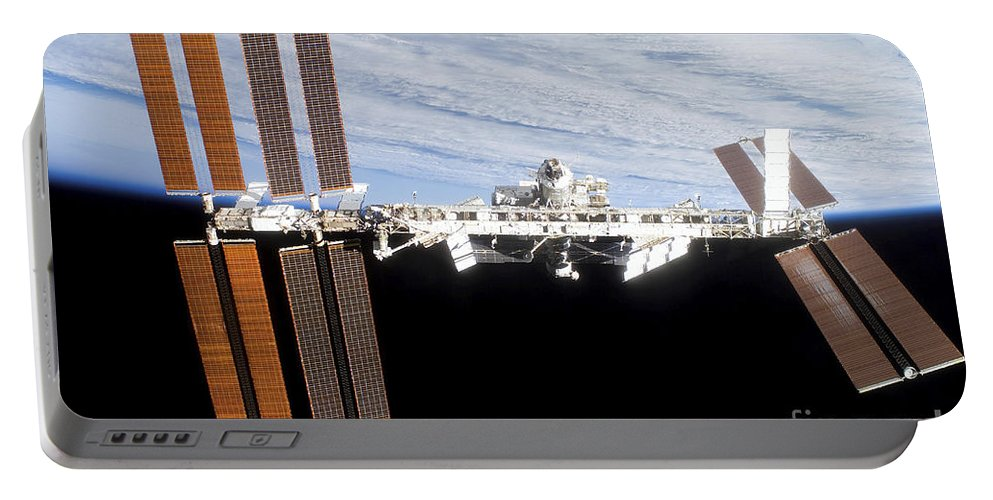 Blue Portable Battery Charger featuring the photograph International Space Station by Stocktrek Images