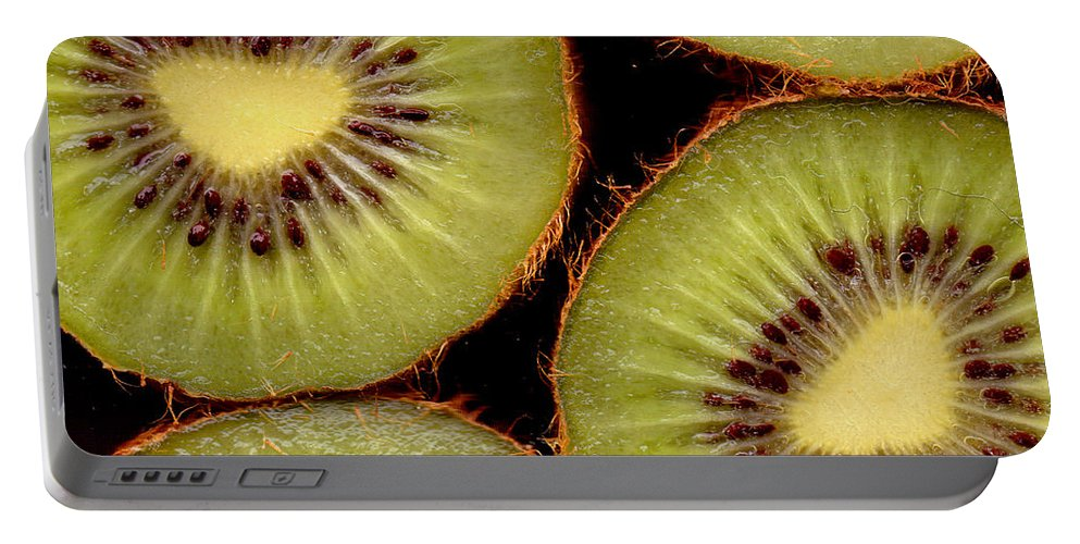 Kiwis Portable Battery Charger featuring the photograph 4 Kiwi by Nancy Mueller