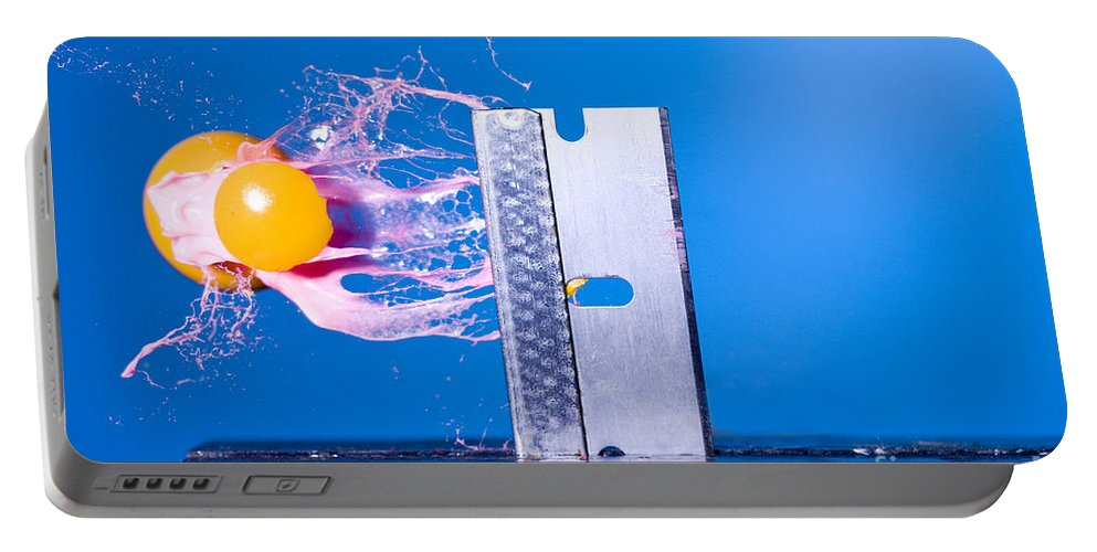 Paintball Portable Battery Charger featuring the photograph Paintball Shot At Razor Blade by Ted Kinsman
