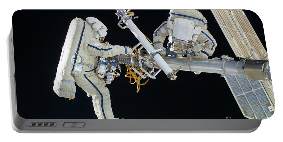 Color Image Portable Battery Charger featuring the photograph Russian Cosmonauts Working by Stocktrek Images
