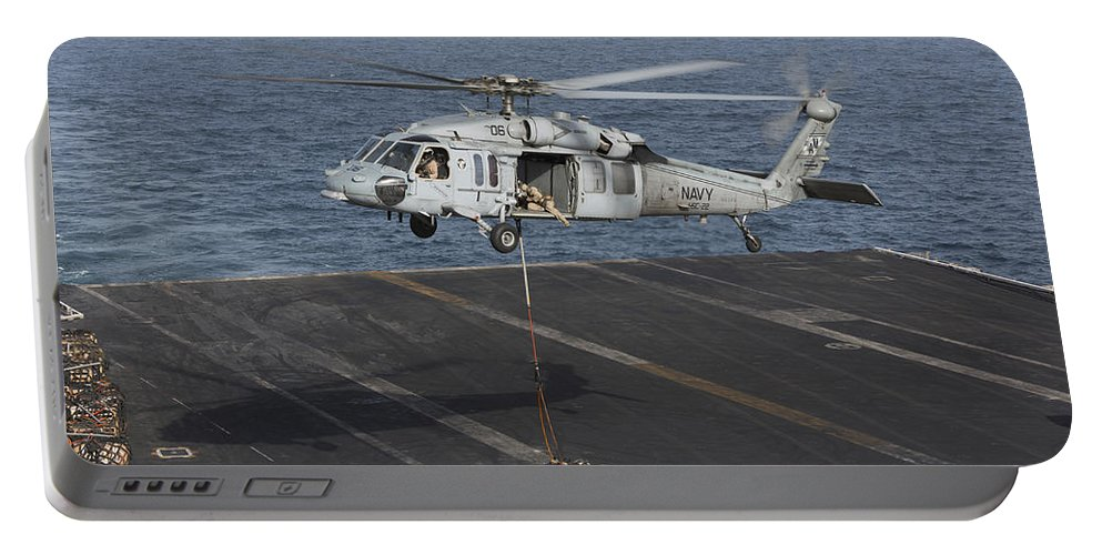 Arabian Sea Portable Battery Charger featuring the photograph A Mh-60s Knighthawk Conducts A Vertical by Gert Kromhout