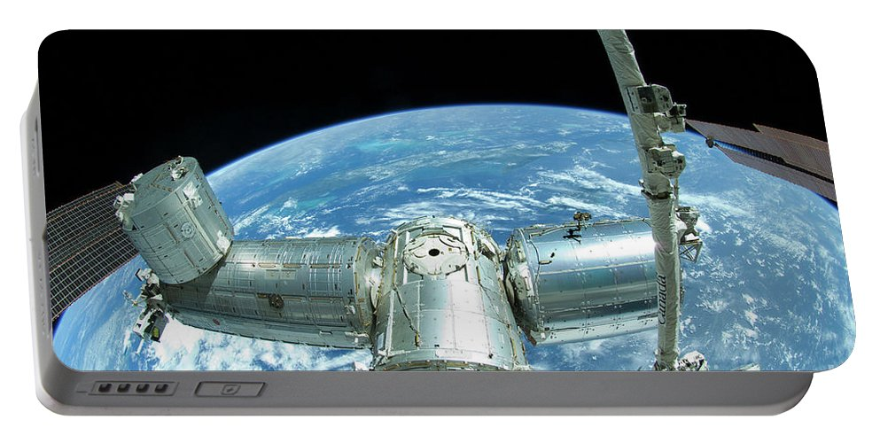 Color Image Portable Battery Charger featuring the photograph A Portion Of The International Space by Stocktrek Images