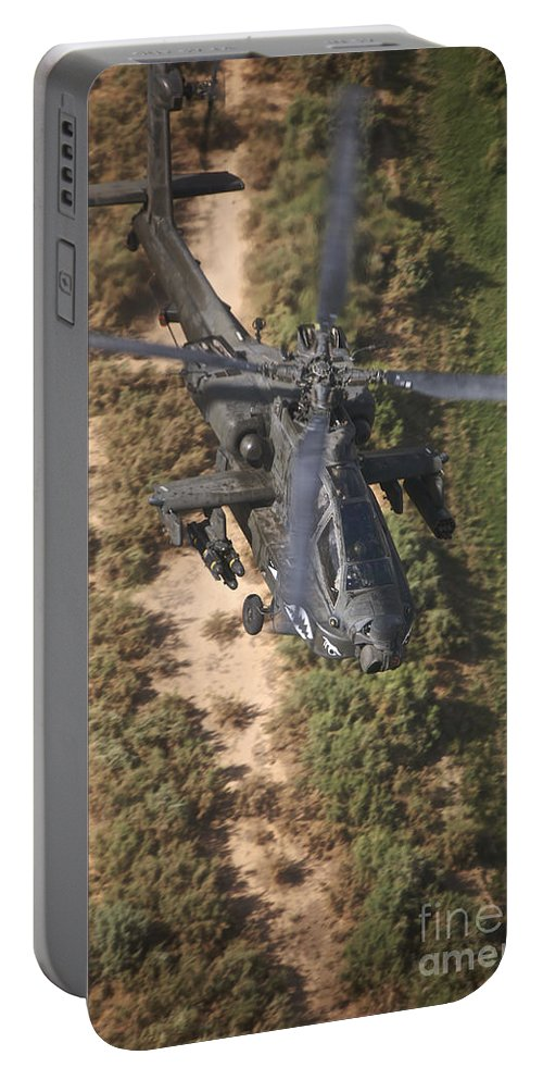 Ah-64 Portable Battery Charger featuring the photograph An Ah-64d Apache Helicopter In Flight by Terry Moore