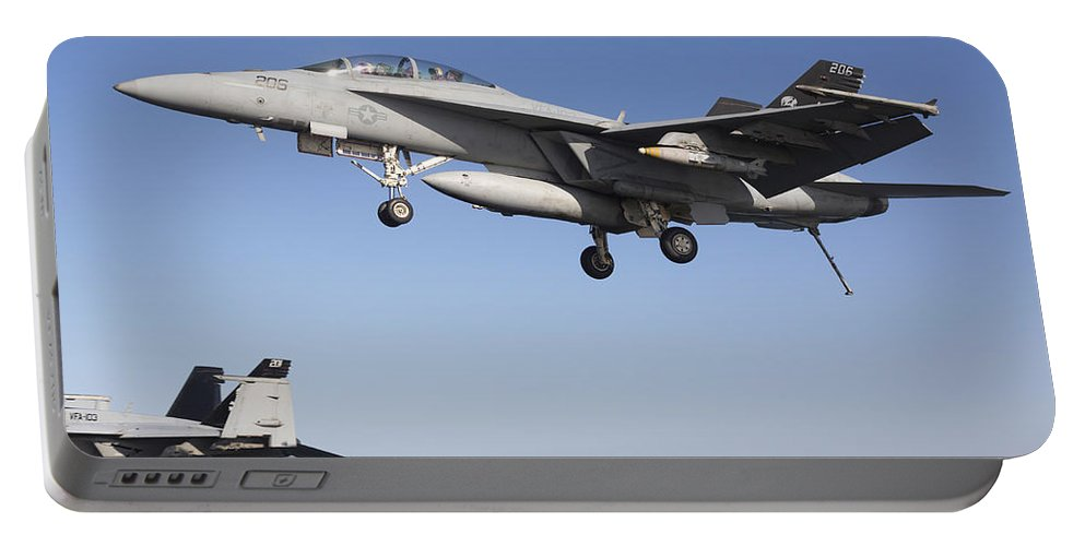 Transportation Portable Battery Charger featuring the photograph An Fa-18f Super Hornet During Flight by Gert Kromhout