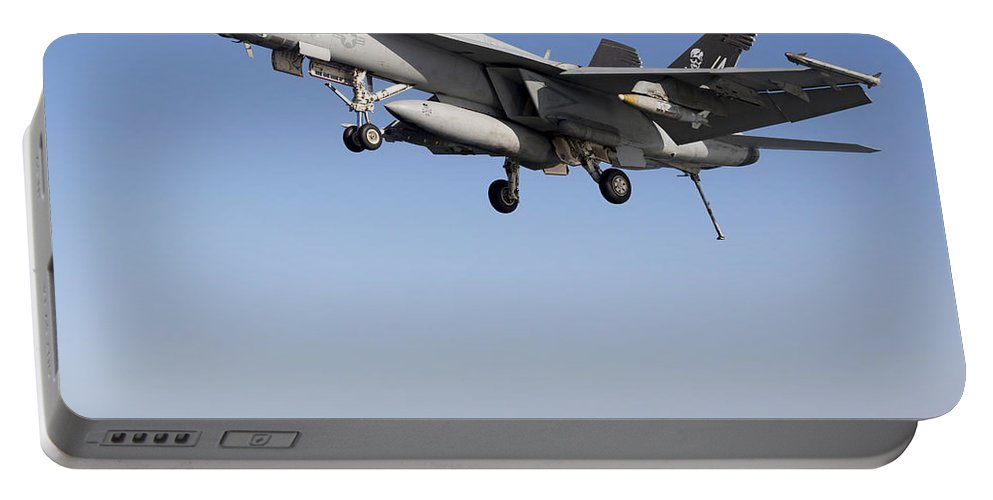 Arabian Sea Portable Battery Charger featuring the photograph An Fa-18f Super Hornet During Flight by Gert Kromhout