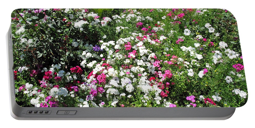 Bed Portable Battery Charger featuring the photograph A Bed Of Beautiful Different Color Flowers by Ashish Agarwal