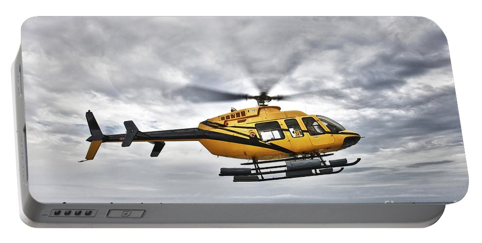 Helicopter Portable Battery Charger featuring the photograph A Bell 407 Utility Helicopter Prepares by Terry Moore