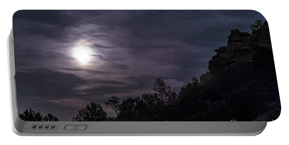 Beauty Portable Battery Charger featuring the photograph A Bright Moon Rises Through Clouds by John Davis