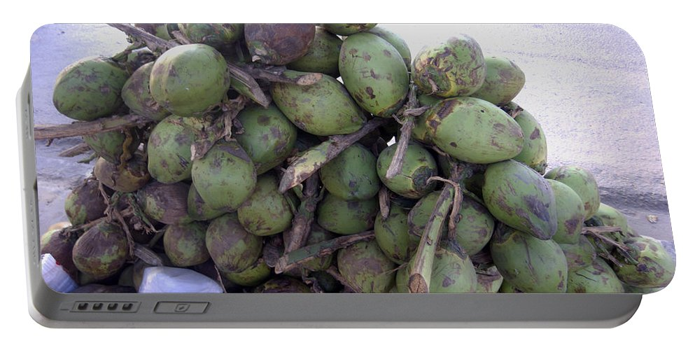 Tender Portable Battery Charger featuring the photograph A Bunch Of Tender Coconuts Being Sold By A Vendor On The Street by Ashish Agarwal
