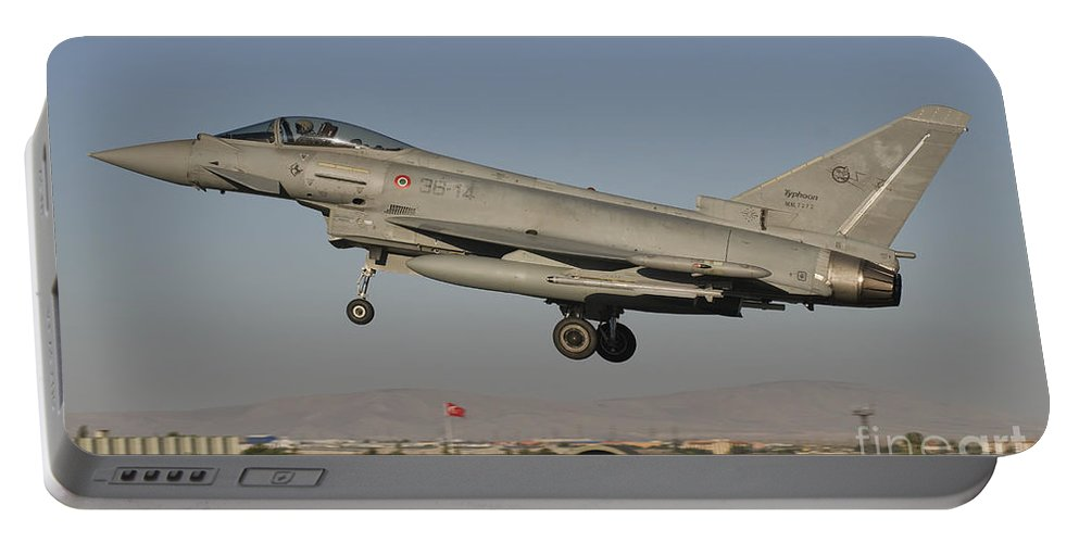 Turkey Portable Battery Charger featuring the photograph A Eurofighter F-2000 Of The Italian Air by Giovanni Colla