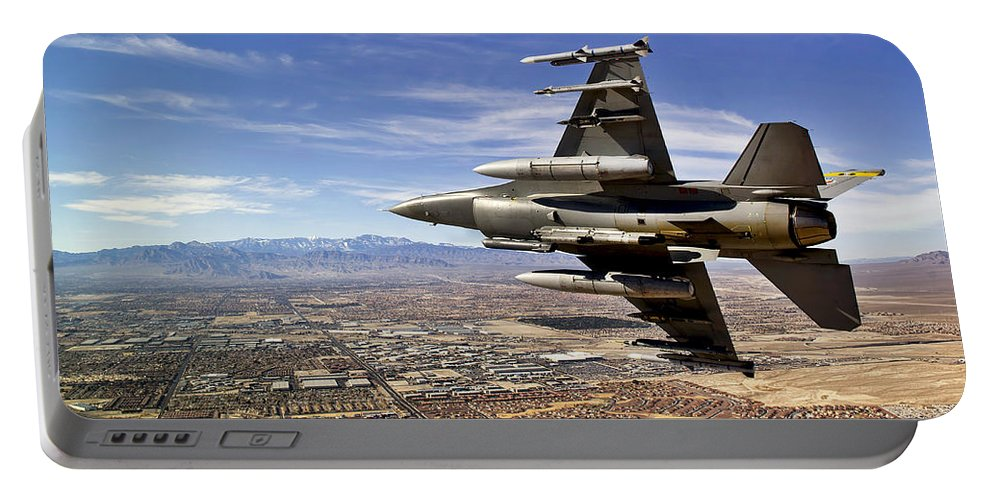 F-16 Portable Battery Charger featuring the photograph A Fighter Jet Breaks Right On A Final by Stocktrek Images
