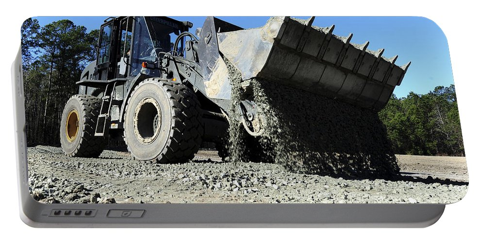 Construction Portable Battery Charger featuring the photograph A Front End Loader Raising A Road Bed by Stocktrek Images