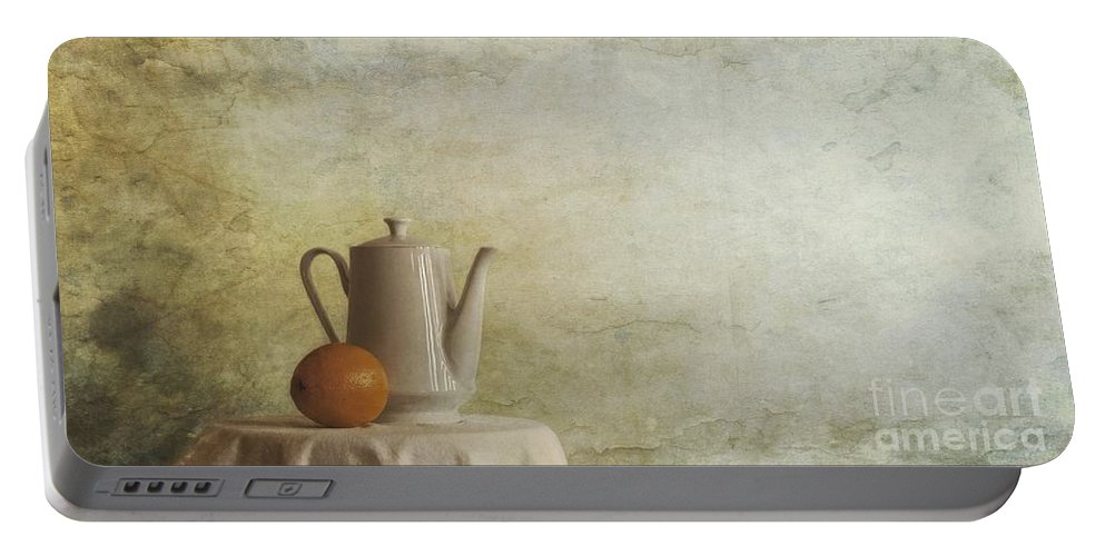 Table Portable Battery Charger featuring the photograph A Jugful Tea And A Orange by Priska Wettstein