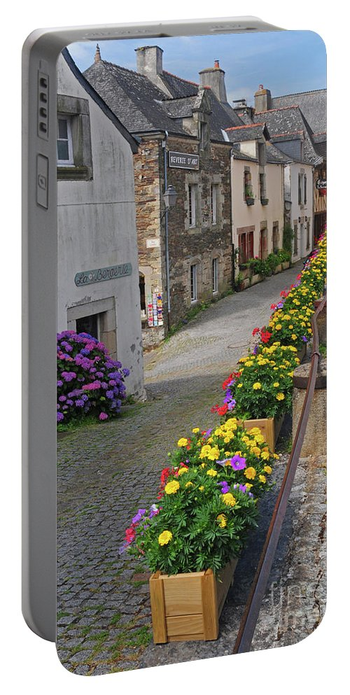 Flowers Portable Battery Charger featuring the photograph A Line Of Flowers In A French Village by Dave Mills