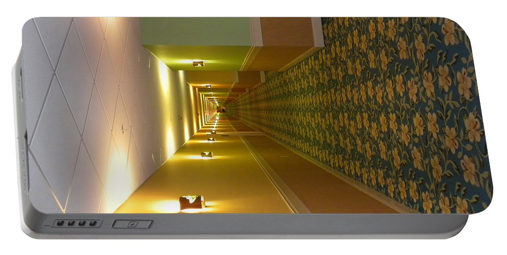 Hallway Portable Battery Charger featuring the photograph A Long Hallway Flipped Sideways by Thomas Woolworth