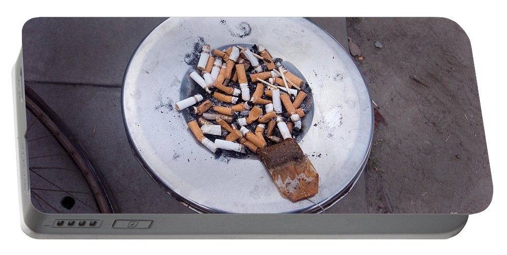 Stubs Portable Battery Charger featuring the photograph A Lot Of Cigarettes Stubbed Out At A Garbage Bin by Ashish Agarwal