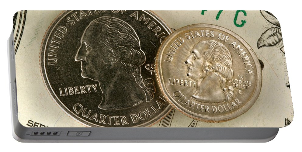 Shrunken Portable Battery Charger featuring the photograph A Magnetically Shrunken Quarter by Ted Kinsman