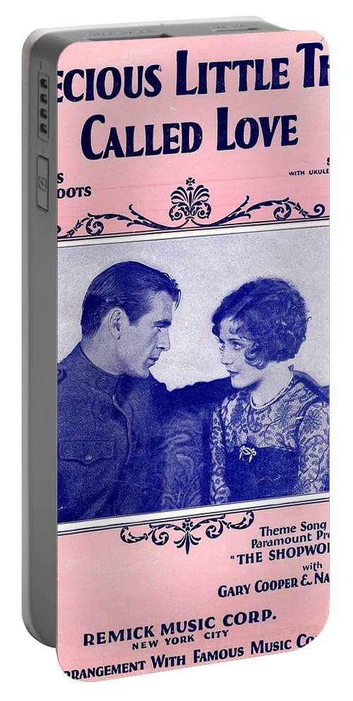 Classic Portable Battery Charger featuring the photograph A Precious Little Thing Called Love by Mel Thompson