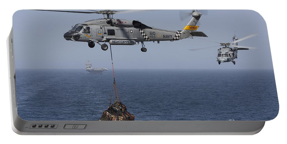 Arabian Sea Portable Battery Charger featuring the photograph A Sh-60j Seahawk Transfers Cargo by Gert Kromhout