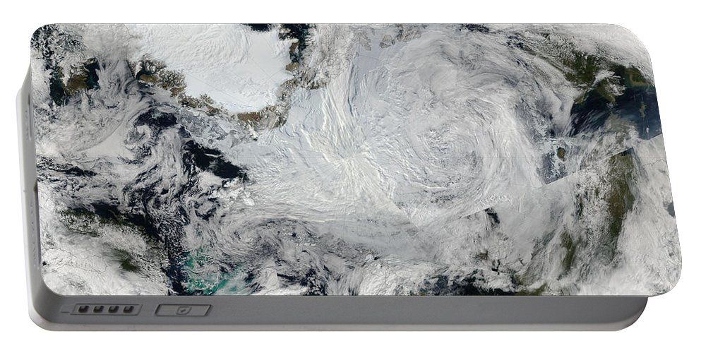 Color Image Portable Battery Charger featuring the photograph A Strong Storm Lingering In The Center by Stocktrek Images