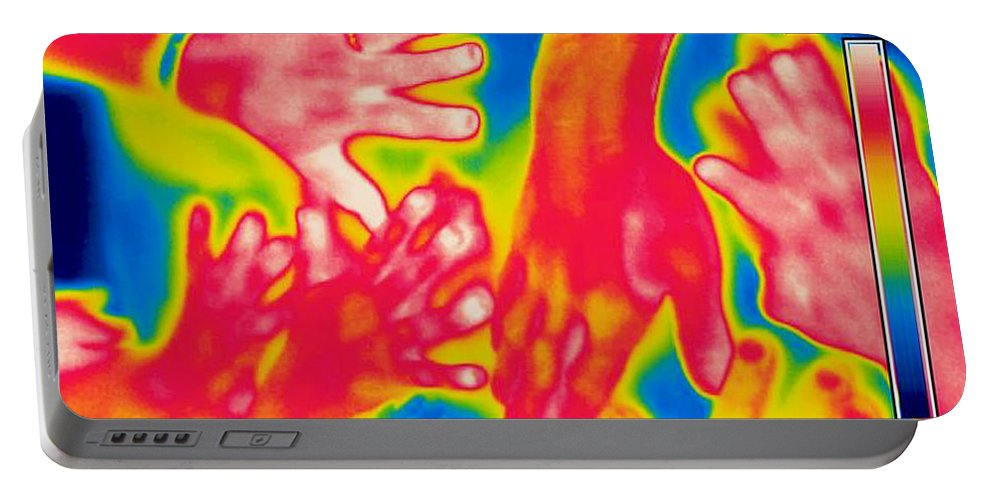Thermogram Portable Battery Charger featuring the photograph A Thermogram Of A Pile Of Human Hands by Ted Kinsman