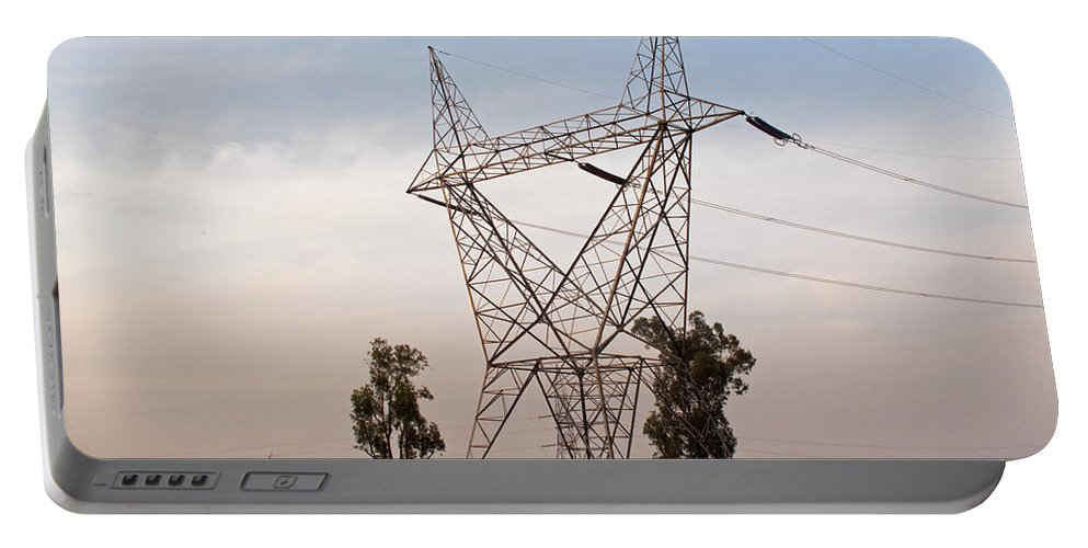 India Portable Battery Charger featuring the photograph A Transmission Tower Carrying Electric Lines In The Countryside by Ashish Agarwal