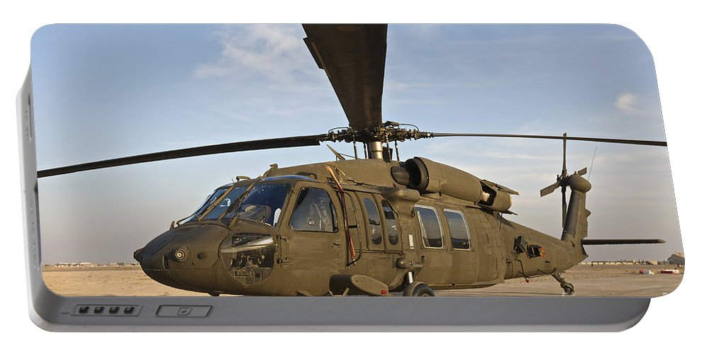 Operation Iraqi Freedom Portable Battery Charger featuring the photograph A Uh-60 Black Hawk Parked At A Military by Terry Moore