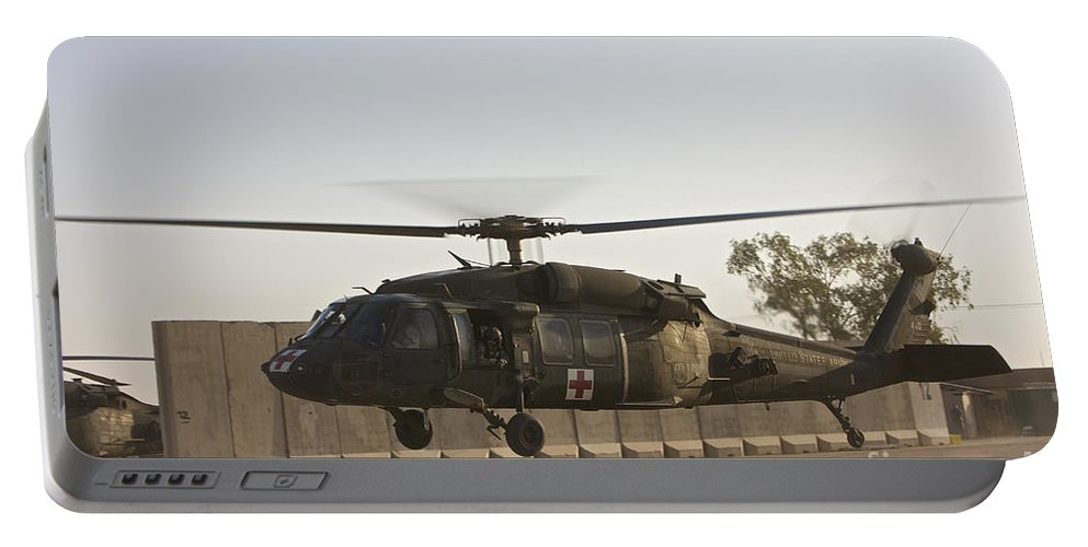 Aviation Portable Battery Charger featuring the photograph A U.s. Army Medevac Uh-60 Black Hawk by Terry Moore