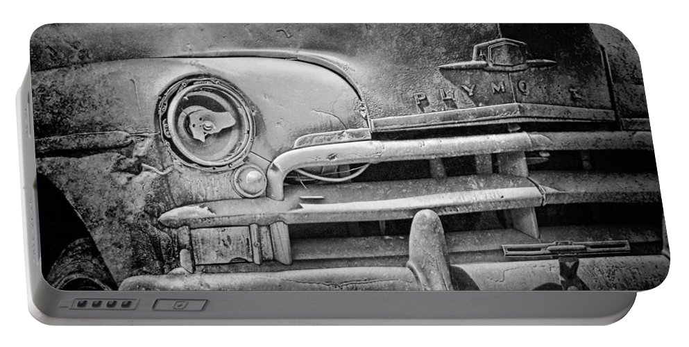Art Portable Battery Charger featuring the photograph A Vintage Junk Plymouth Auto by Randall Nyhof