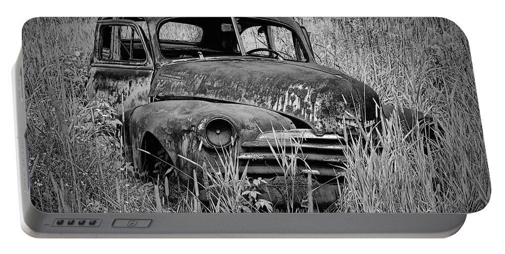 Art Portable Battery Charger featuring the photograph Abandoned Vintage Car Along The Roadside by Randall Nyhof