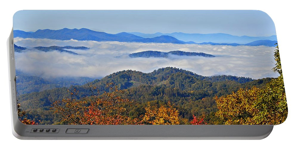 Landscape Portable Battery Charger featuring the photograph Above The Clouds by Susan Leggett