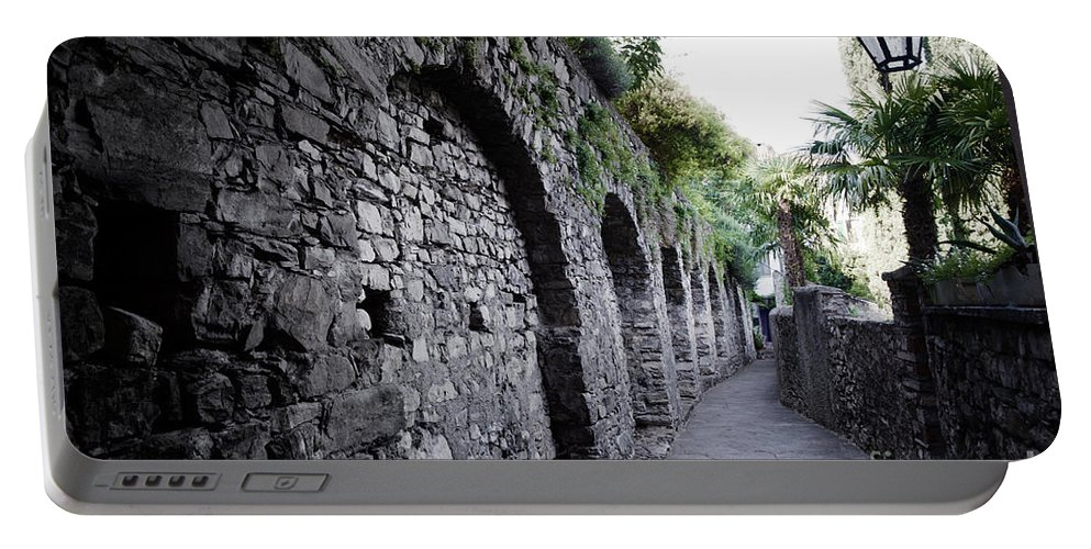 Alley Portable Battery Charger featuring the photograph Alley With Arches by Mats Silvan